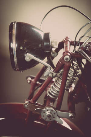 Close up shot of a classic vintage motorcycle headlight.