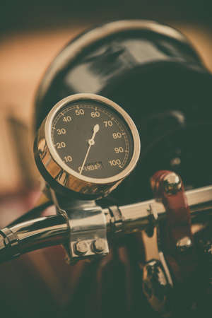 Close up vertical image of the speedometer gauge of a vintage motorcycle. Stockfoto