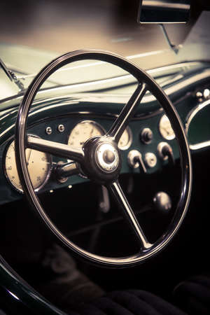 Color close up of the steering wheel of an old classic car. Stock Photo