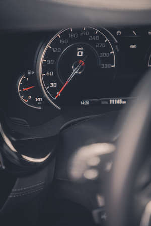 Close up shot with the speedometer of a car.