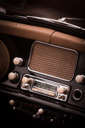 Close up shot of a classic vintage car stereo on the dashboard. Reklamní fotografie