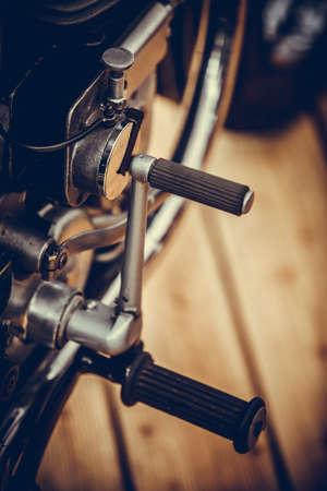 Close up shot of a vintage motorcycle kick start lever.