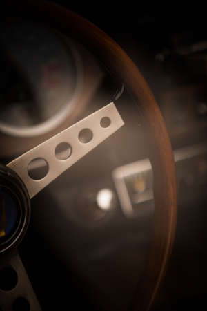 Color close up of the wooden steering wheel of an old classic car. Stock fotó - 133231959