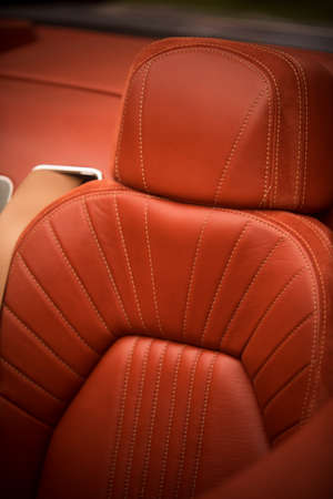 Color detail of the leather seats of a sports car.
