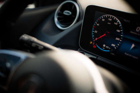 Close up shot with the digital speedometer on a modern car dashboard.