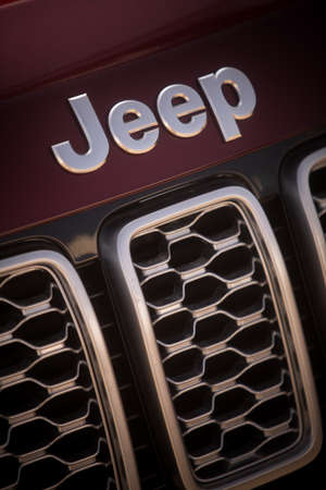 Bucharest, Romania - October 23, 2019: Illustrative editorial close up shot of the Jeep logo on a car. Jeep is a brand of American automobile. Editorial