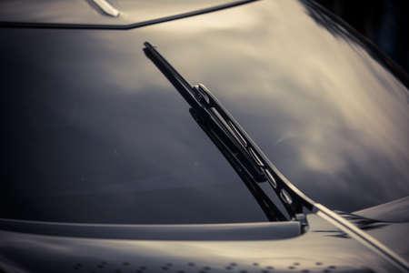 Close up shot of modern sports car windscreen wipers.