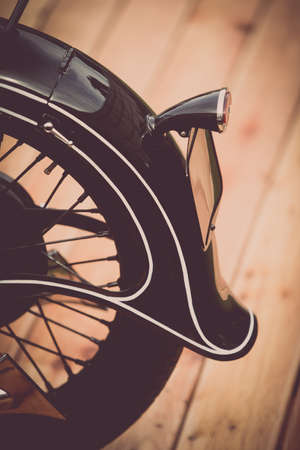 Close up image of the rear fender of a retro motorcycle.