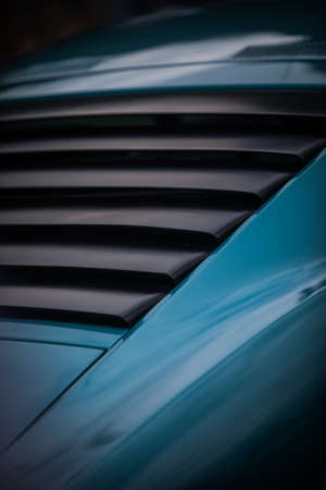 Close up shot of the rear window plastic shades of a classic vintage car.