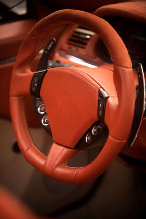 Close up shot of a modern car leather steering wheel.