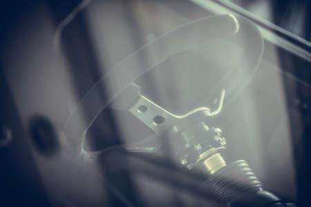 Close up shot of a sport car racing steering wheel.