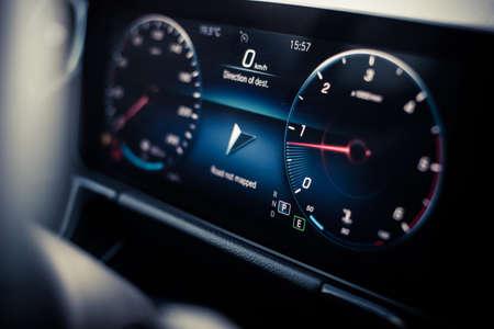 Close up shot with the digital dashboard of a car. Reklamní fotografie