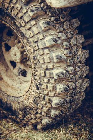 Close up shot of a muddy off road tire on a 4x4 car. Reklamní fotografie