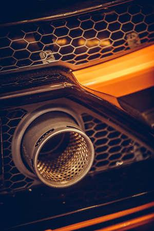 Close up horizontal shot of a sport car exhaust pipe. Reklamní fotografie