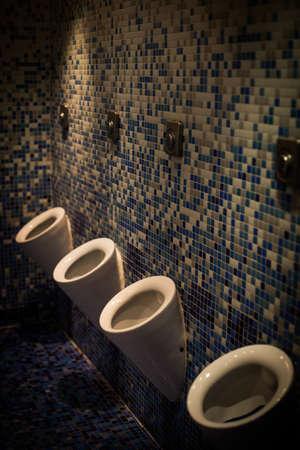 Color image of a mens public toilet.