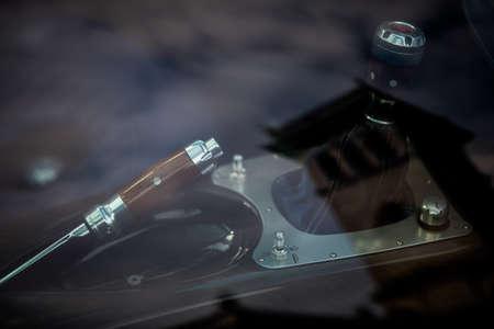 Close up shot of a sport car wooden handbrake and gear shifter.