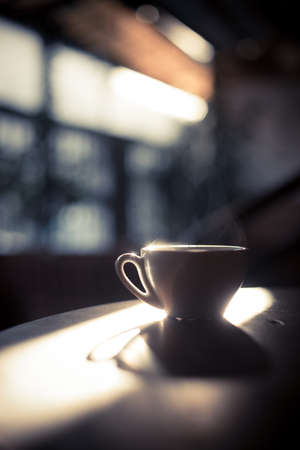 Image of a steamy coffee cup in the sunlight, with shallow depth of field. Reklamní fotografie