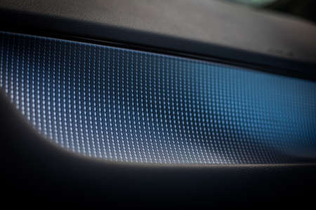 Macro image of the texture on the dashboard of a new car.