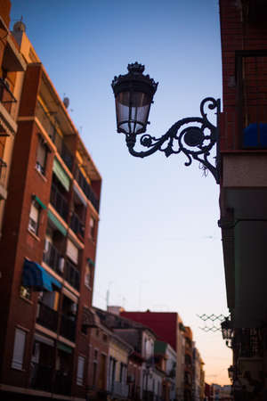 Image of a vintage lamp on a street, at dusk. Reklamní fotografie