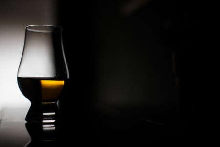 Close up shot of a Glencairn whisky glass.