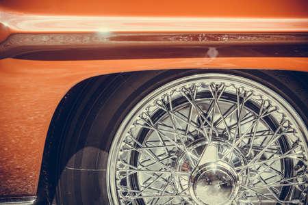 Close up shot of a vintage classic car spoke wheel. Reklamní fotografie