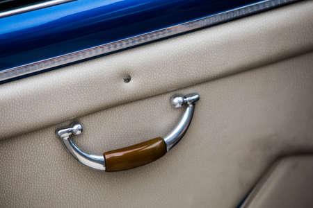 Close up shot of a vintage car door handle from the inside. Reklamní fotografie