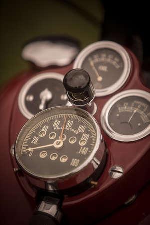 Close up vertical image of the speedometer gauge of a vintage motorcycle. Reklamní fotografie