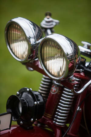 Close up shot of a classic vintage double motorcycle headlight.