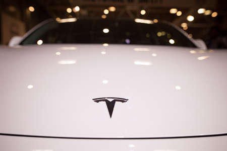 Bucharest, Romania - October 23, 2019: Illustrative editorial close up shot of the Tesla logo on a car. Tesla Inc. is an American automotive and energy company.