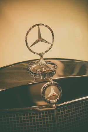 Bucharest, Romania - October 23, 2019: Illustrative editorial close up shot of the Mercedes Benz logo on a vintage car hood. Mercedes Benz is a German global automobile maker. Redakční