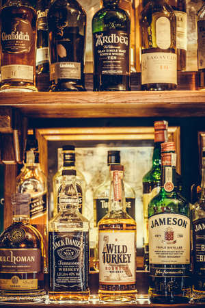 Bucharest Romania - January 27, 2020: Various bottles of alcohol are displayed in bar in Bucharest, Romania. Redakční