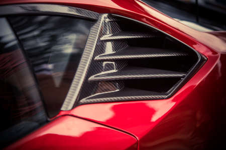 Color close up of the carbon air vents of a sport car.
