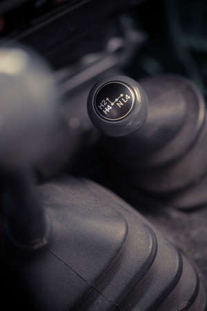 Close up image of a 4wd cars 4x4 shifter.
