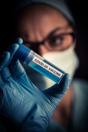 Conceptual image of a nurse holding a recipient with the coronavirus COVID-19 vaccine. Stock Photo