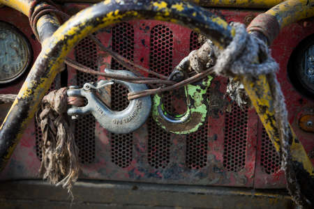 Close up shot of the hook of a winch on a dirty off road vehicle. Reklamní fotografie