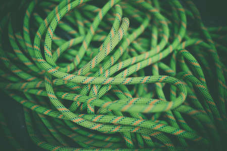Close up shot of a pile of green rock climbing rope.