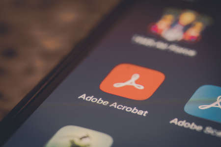 Bucharest, Romania - December 13, 2020: Illustrative editorial close up image of the Adobe Acrobat mobile app on a smartphone screen. Editorial