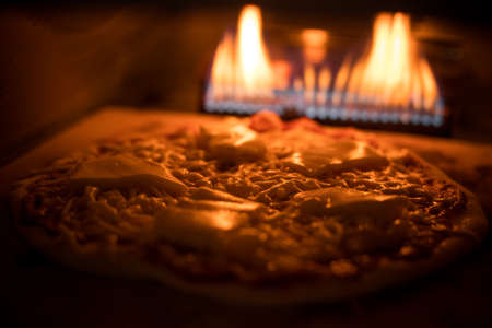 Close up shot of a pizza baking in an oven.