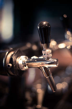Close up shot of a beer tap in a bar.