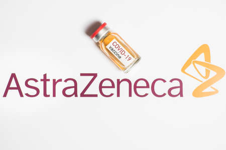 Bucharest, ROMANIA - March 15, 2021: Illustrative editorial concept image with a dose of the new Coronavirus COVID-19 vaccine, with the AstraZeneca logo in the background.