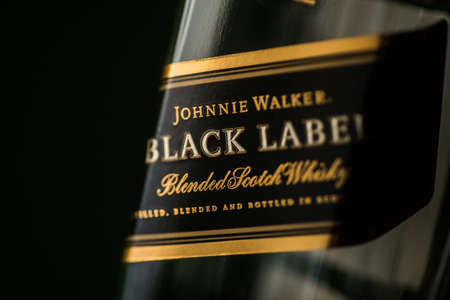 Bucharest, Romania - November 9, 2020: Illustrative editorial image of a Johnnie Walker Black Label blended scotch whisky bottle displayed in a pub in Bucharest, Romania.