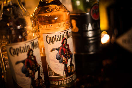 Bucharest, Romania - November 9, 2020: Illustrative editorial image of some Captain Morgan rum bottles displayed in a pub in Bucharest, Romania.