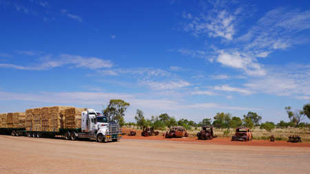road train transporting hay stop over Stok Fotoğraf