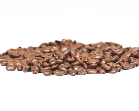 acidity: Coffee beans on white background