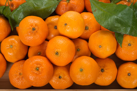 plate: Tangerines on wooden plate Stock Photo