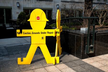 under ground: Sign, caution ground under repair
