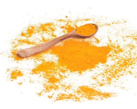 curcumin: Turmeric powder and wooden spoon on white background Stock Photo
