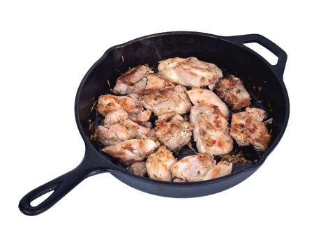 skillet: Chicken thighs and cast iron skillet on white background