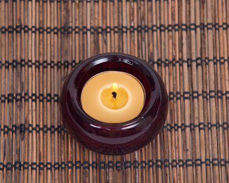 candleholder: Burning candle in decorative candleholder Stock Photo
