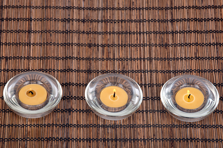 Burning candles in decorative candleholders